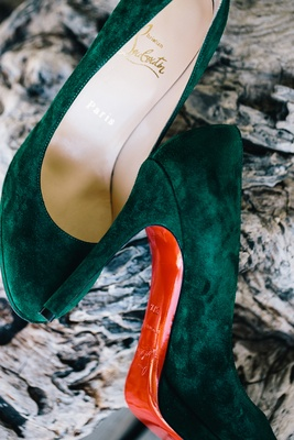 Green suede Christian Louboutin heels in green with red soles