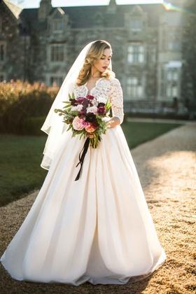 bride ball gown bouquet courtyard ersa atelier wedding dress illusion sleeves full skirt veil
