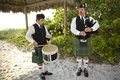 Bagpipe entertainment duo on sand beach