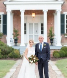 Southern wedding bride and groom bride in lace bodice dress with magnolia bouquet groom in navy suit