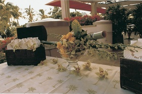 flowers and seashells decorate white table