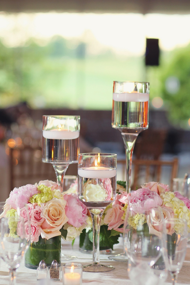 Reception dcor photos pink and ivory floral centerpieces floating candles in monet glass vases and short arrangements reviewsmspy