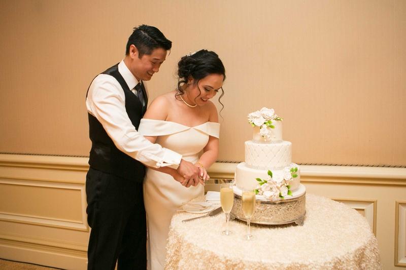 Cakes & Desserts Photos - Newlyweds Cutting Cake Together - Inside ...