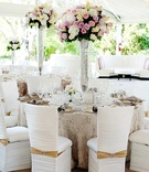 Tent wedding table arrangement with textured linens