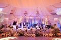 Live wedding band stage with fabric and flower border