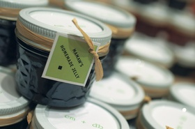 Jars of jam tied with raffia and green label