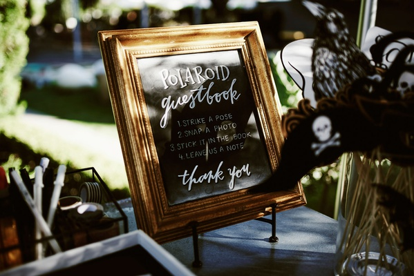 wedding guest book sign chalkboard gold frame strike a pose snap a photo stick it in the book