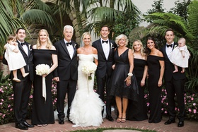 group photo of family at wedding, everyone except bride and two very young flower girls in black
