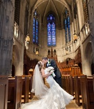 Groom dipping bride for kiss in Pittsburgh church