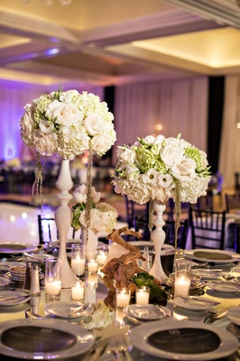 modern and magical centerpieces, decorative vases, tree branch centerpiece, candles purple lighting