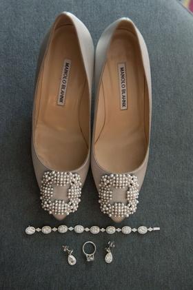 Bride's day of wedding accessories bracelet engagement ring earrings manolo blahnik shoes pearls