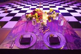 Mirror tabletop in front of checkered wedding dance floor