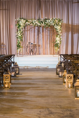 chuppah with white flowers green leaves and twigs jewish wedding