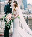bride in pronovias mermaid wedding dress with lace bodice, groom in tuxedo