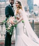 bride in pronovias mermaid wedding dress with lace bodice, groom in tuxedo