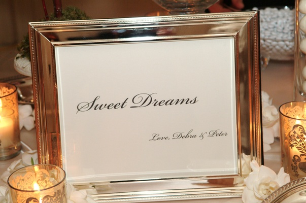 Silver frame with Sweet Dreams sign for wedding dessert table