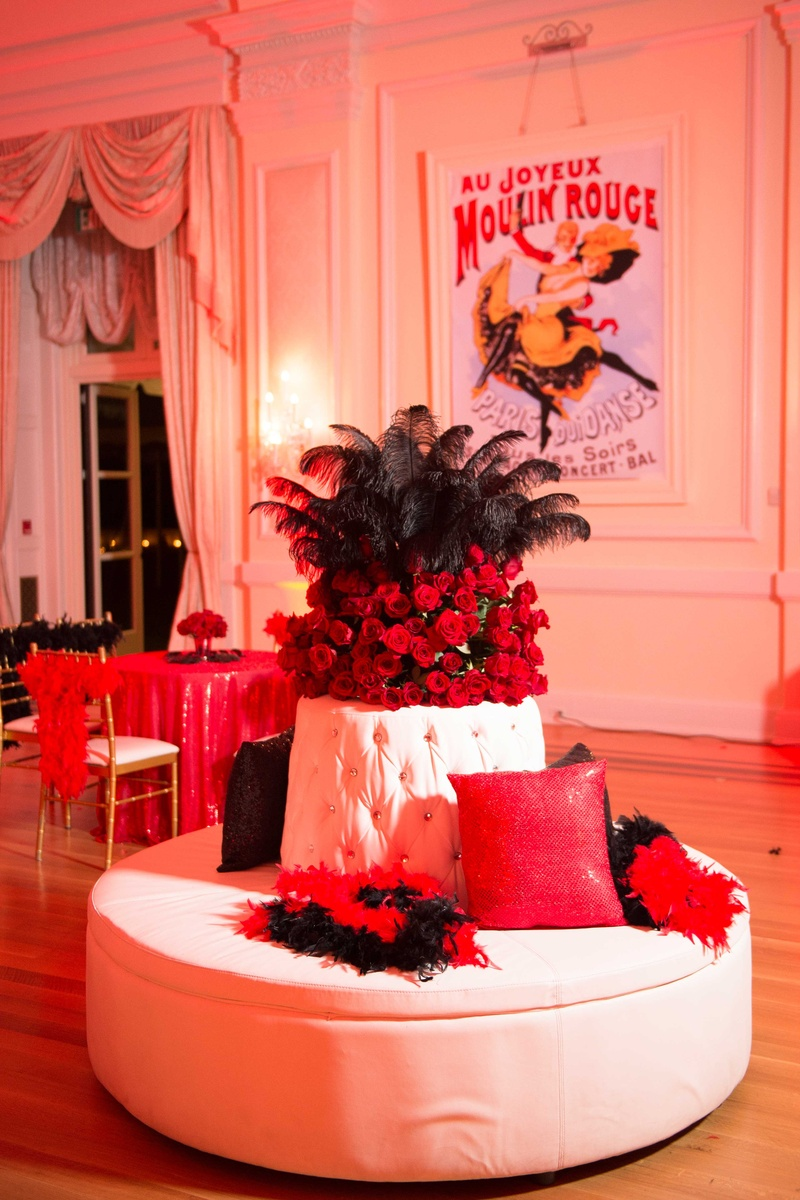 after parties photos - red & black feather boa décor - inside weddings