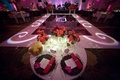 Couples table with view of dance floor and monogram