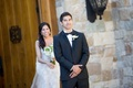 Bride walks up to groom who waits anxiously for his bride with crossed arms side eye