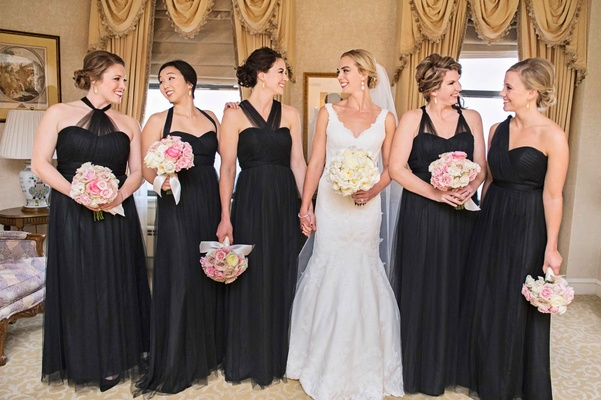 bride in matthew christopher, bridesmaids in jenny yoo black mismatched bridesmaid dresses