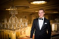 groom in jos. a. bank tuxedo inside the drake hotel by chandelier
