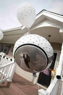 Wedding celebration balloons outside reception