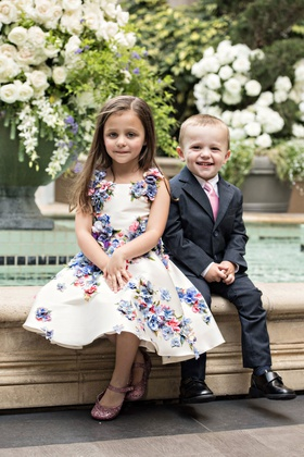 sweet little girl in flower print dress and boy in suit with pink tie for 50th anniversary party