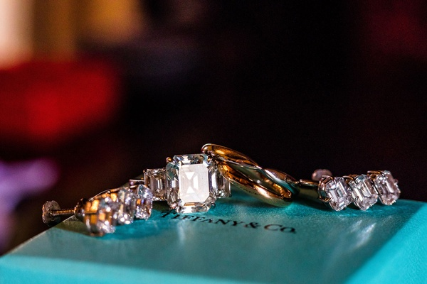 wedding jewelry on top of tiffany and co box emerald cut diamond ring with side stones