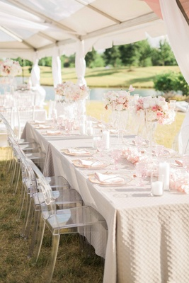 rectangle tables at wedding reception blush and ivory florals, ghost chairs