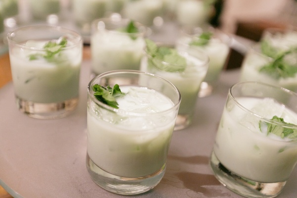 Winter wedding reception table with milky, mint cocktails topped with mint