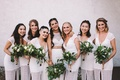 bride in crop top wedding dress from bhldn, pearl headpiece, greenery bouquet, bridesmaids in white