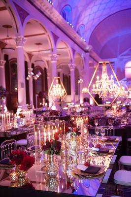 Vibiana wedding reception with mirror table, taper candles in Lucite box, and purple lighting