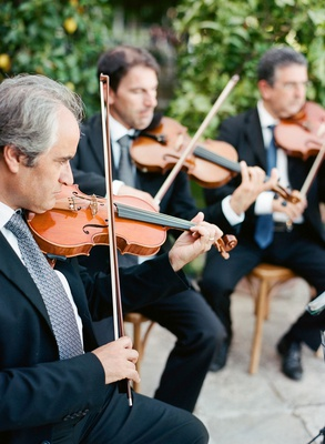 Wedding ceremony quartet of string instruments playing at outdoor ceremony wedding entertainment