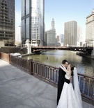 Bride and groom in front of Chicago, Illinois skyline