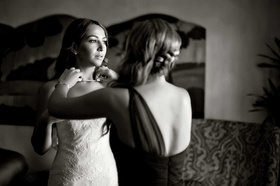 bride gets dressed black and white