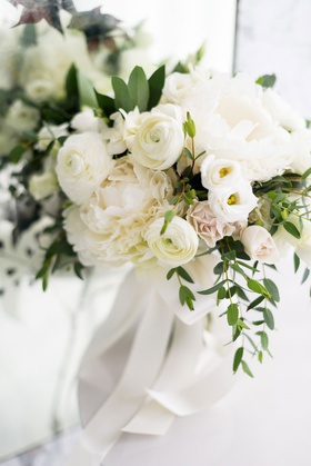 romantic wedding bouquet blush rose white ranunculus and peony flowers greenery ribbon