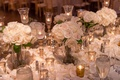 classic wedding with white roses and crystal candle holders, gold votives