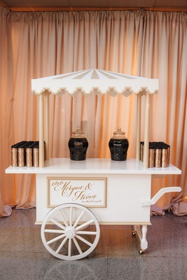 Cute coffee bar cart at wedding reception drapery coffee holder thermos on white cart tray wedding