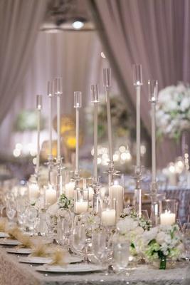 long arrangement glass candles floral runner shimmering linen greenery classic wedding reception