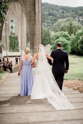 bride's parents walk her down steps aisle altar portland park outdoor wedding lavender dress veil