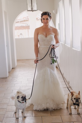 Bride wearing trumpet-style gown with pugs