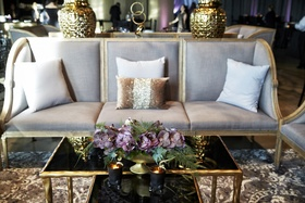 grey lounge furniture with gold accents, purple moth orchids, cocktail hour wedding