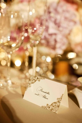 Donatella Arpaia's wedding seating card in gold