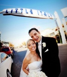 Newlyweds by Little Italy sign in San Diego