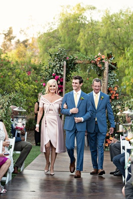 wedding ceremony processional groom with father matching suit tie and mother elie saab pink gown