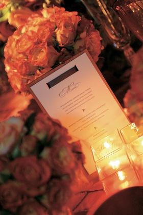 Wedding menu attached to wood slat