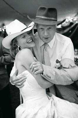Black and white photo of bride and father of bride in cowboy hats