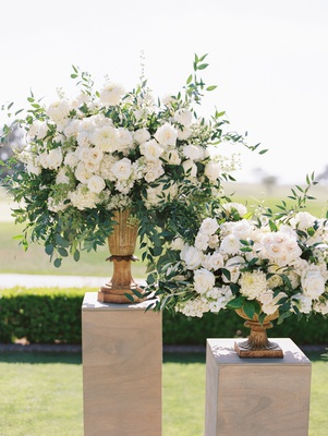 wedding ceremony at the lodge at torrey pines white rose flowers greenery urns wood risers