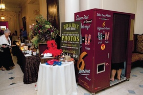 Wedding guests inside large photo booth