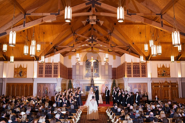 New Year's Eve wedding ceremony at Catholic church minimal decor priest bridesmaids groomsmen
